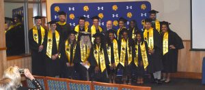 Student-Athletes in their graduation regalia